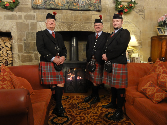 Wedding pipers and drummers at the fireside