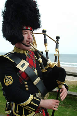 Bamburgh Castle Piper